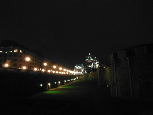 Approaching the Tower of London and the Tower Bridge at night.