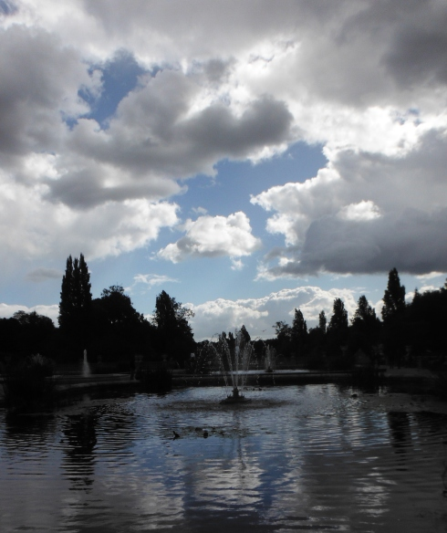 Cloud reflection in the beautiful Italian gardens. Hyde Park.
