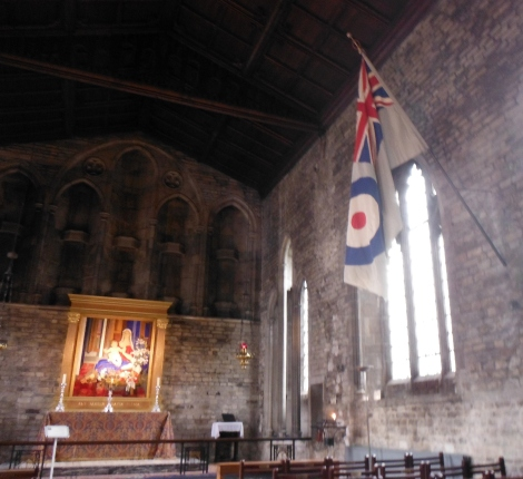 The Mary Chapel off of the Church of St. Bartholomew, the flag of the British Air Force in the foreground.