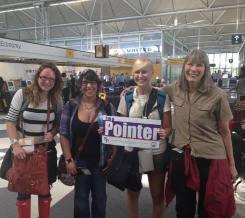 Cherish, Lindsey, Linnea, and Kathe at Heathrow showing some Pointer pride.
